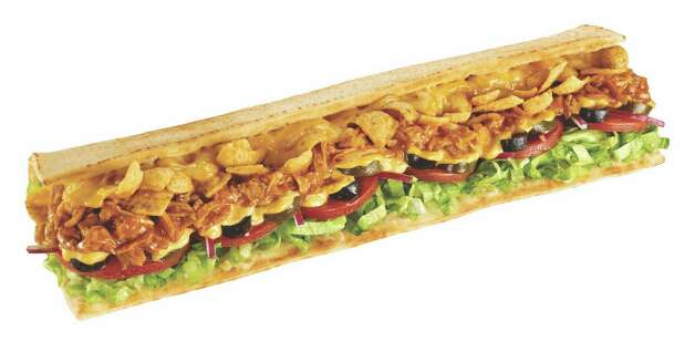 "Fritos Chicken Enchilada Melt, new at Subway: Shredded chicken, ""authentic"" enchilada sauce, Monterey Cheddar, a 
