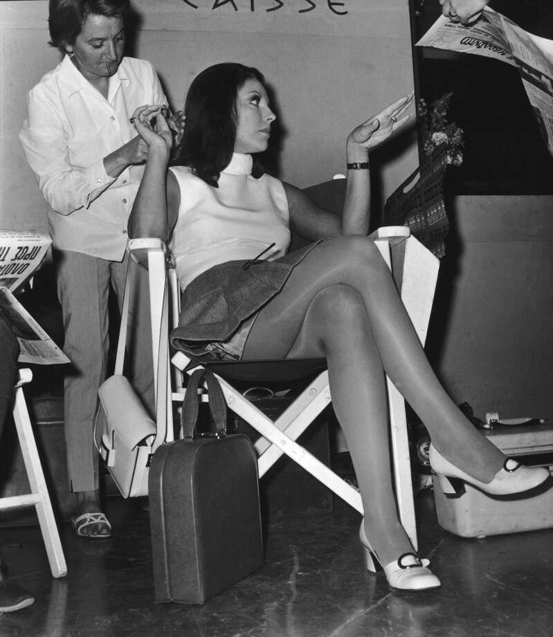 British actress Joan Collins prepares to shoot a scene for 'The Executioner', directed by Sam Wanamaker, at the Hilton Hotel in Athens, 22nd May 1969. Photo: Keystone/Hulton Archive, Getty Images