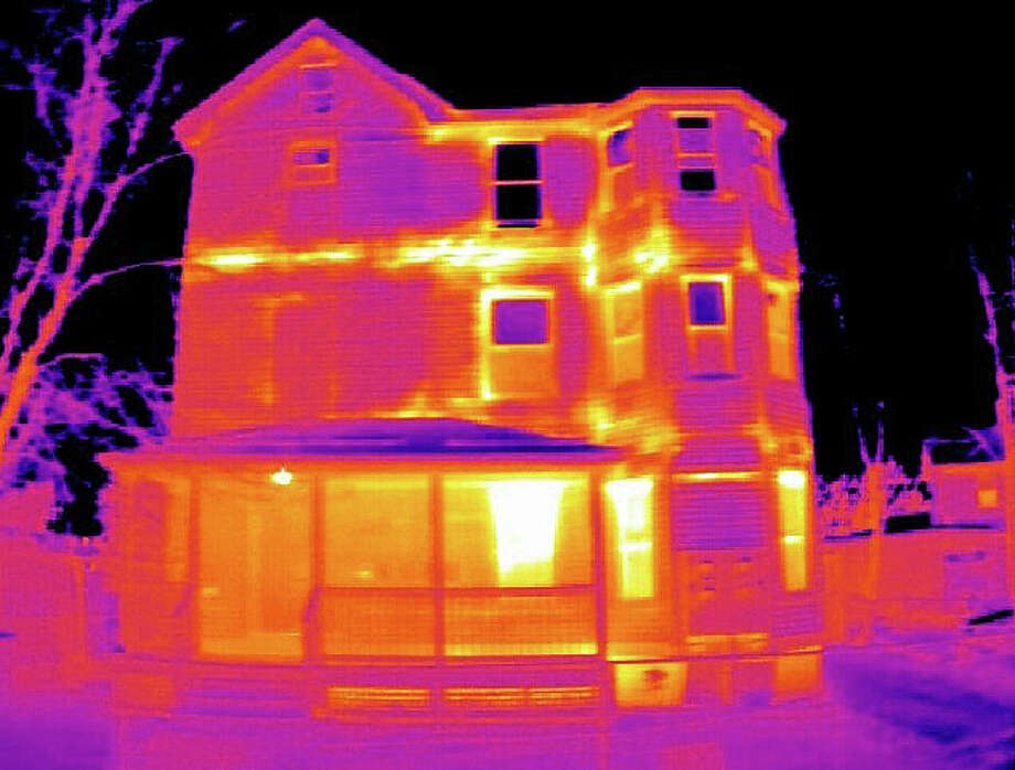 A thermal image of a house taken by Sagewell, Inc., illustrates high heat loss from the building in those areas showing yellow or lighter tones. Thermal images of Westport homes by the firm are available to owners through a program sponsored by the town's Green Task Force to promote greater energy efficiency. Photo: Contributed Photo / Westport News contributed