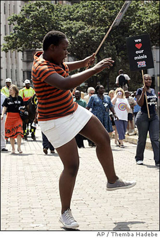 A woman wearing a miniskirt dances during a protest march in Johannesburg, South Africa, Tuesday March 4, 2008, in protest against the sexual harassment of a miniskirt-wearing woman at the city center the previous month. The march was the second in reaction to an attack by taxi drivers and hawkers on a 25-year-old woman for wearing a miniskirt. Photo: Themba Hadebe, Associated Press