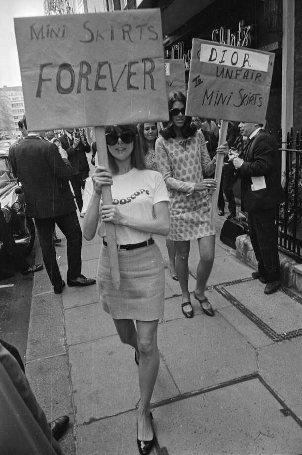 12th September 1966:  Girls from the British Society for the Protection of Mini Skirts stage a protest outside the House of Dior, for its 'unfair' treatment of mini skirts. Photo: Larry Ellis, Express / Getty Images