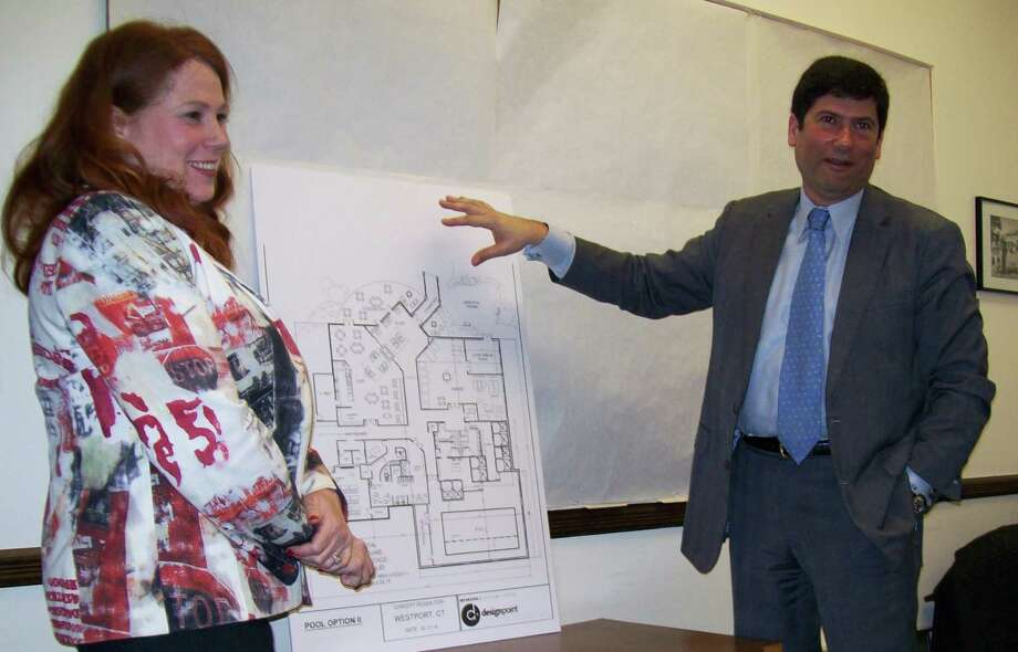 Rachel Rangelov, left, of the Watermark Retirement Communities, and Selectman Avi Kaner explain some of the amenities that will be offered at a community center building attached to the senior housing complex planned on the Baron's Sourth parcel. Photo: Anne M. Amato / Westport News