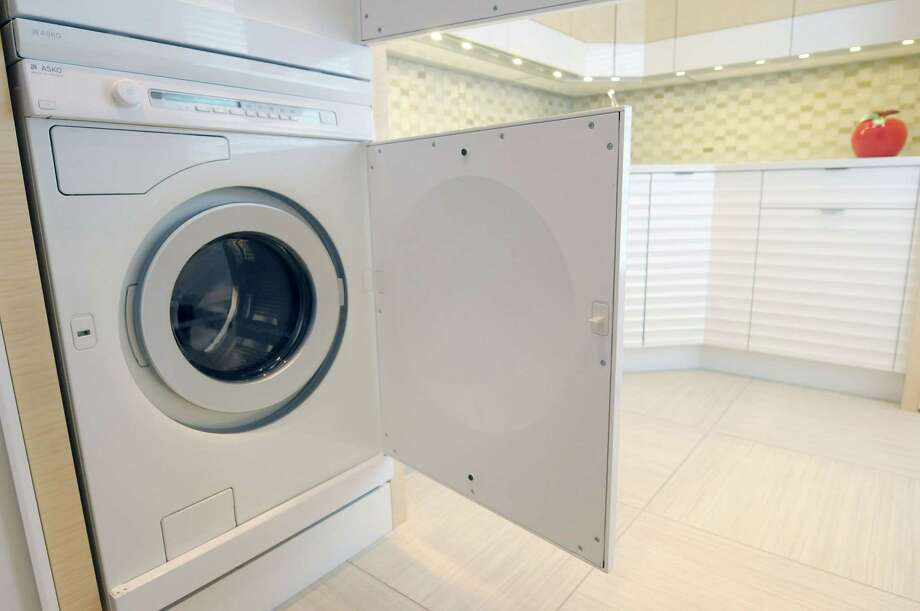 February: Vacuum and wipe down your washer and dryer. Naturally, your  lint drawer should be cleaned out after every other drying session (or  so).  Photo: Paul Buckowski, Albany Times Union / 00020000A