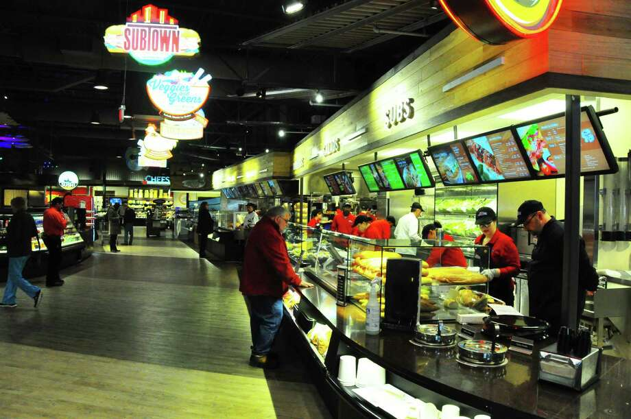 Steve Barnes/Times Union  Dubbed Bistro Boulevard, the food court-style area at Market Bistro by Price Chopper includes counters for made-to-order subs, salads, burritos, chicken, burgers, sushi, fish fry and more.