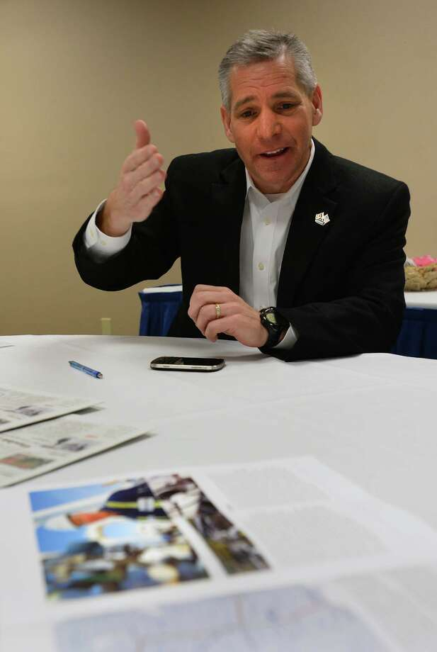TransCanada CEO Russ Girling shows a map of the company's pipeline before an event at Ford Park in Beaumont on Wednesday.   Photo taken Wednesday, February 26, 2014 Guiseppe Barranco/@spotnewsshooter Photo: Guiseppe Barranco, Photo Editor