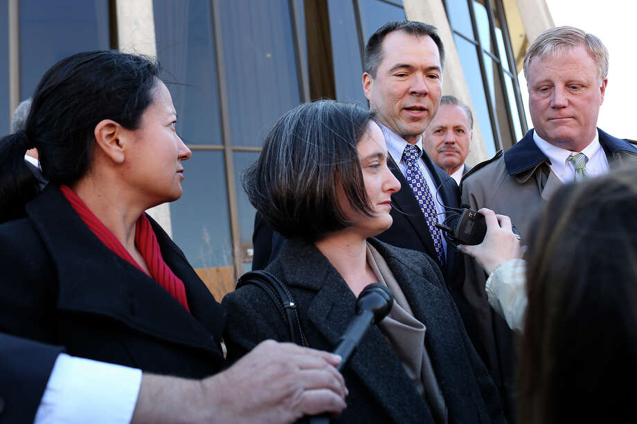 Plaintiffs Cleo DeLeon, from left, with her wife, Nicole Dimetman, and Victor Holmes, with his partner, Mark Phariss, speak to the media after the hearing for their request for a preliminary injunction to declare Texas' ban on same-sex marriage unconstitutional at the John H. Wood, Jr. U.S. Courthouse in San Antonio on Wednesday, Feb. 12, 2014. Photo: LISA KRANTZ, Lisa Krantz / SAN ANTONIO EXPRESS-NEWS