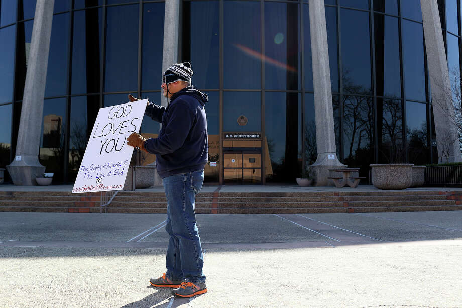 """""""I'm not against anything. I just want people to know Jesus loves them,"""" says Joseph Enderle as he stands in front of the John H. Wood, Jr. U.S. Courthouse during the hearing or a preliminary injunction to declare Texas' ban on same-sex marriage unconstitutional in San Antonio on Wednesday, Feb. 12, 2014. Photo: LISA KRANTZ, Lisa Krantz / SAN ANTONIO EXPRESS-NEWS"""