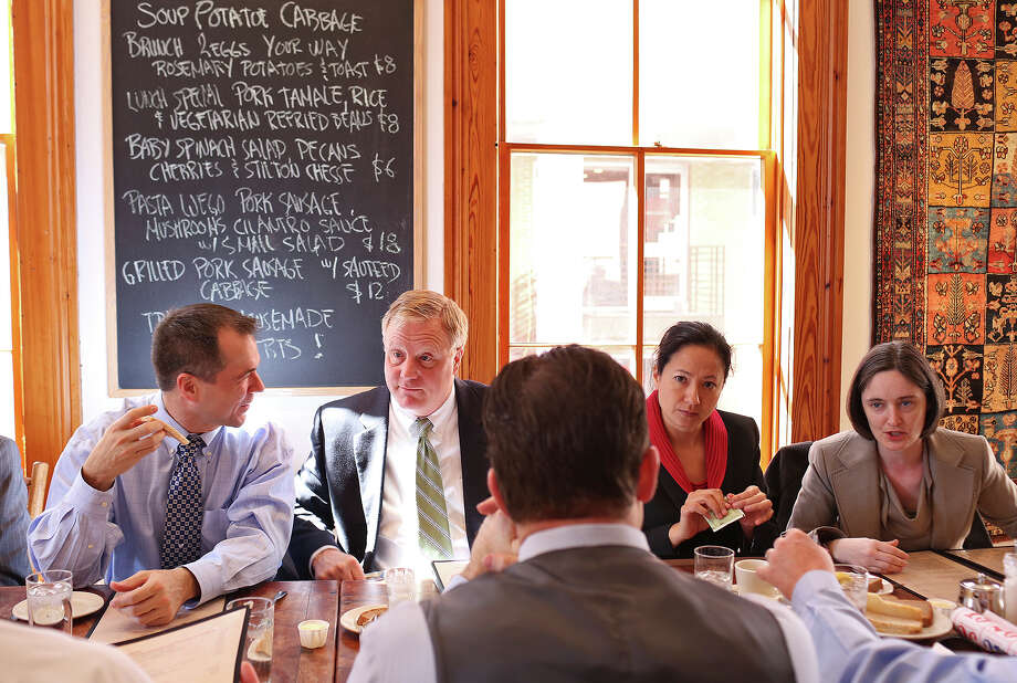 Plaintiffs Victor Holmes, from left, with his partner Mark Phariss, and Cleo DeLeon, with her wife, Nicole Dimetman, have lunch with their legal team at Liberty Bar after the hearing for their request for a preliminary injunction to declare Texas' ban on same-sex marriage unconstitutional at the John H. Wood, Jr. U.S. Courthouse in San Antonio on Wednesday, Feb. 12, 2014. Photo: LISA KRANTZ, Lisa Krantz / SAN ANTONIO EXPRESS-NEWS