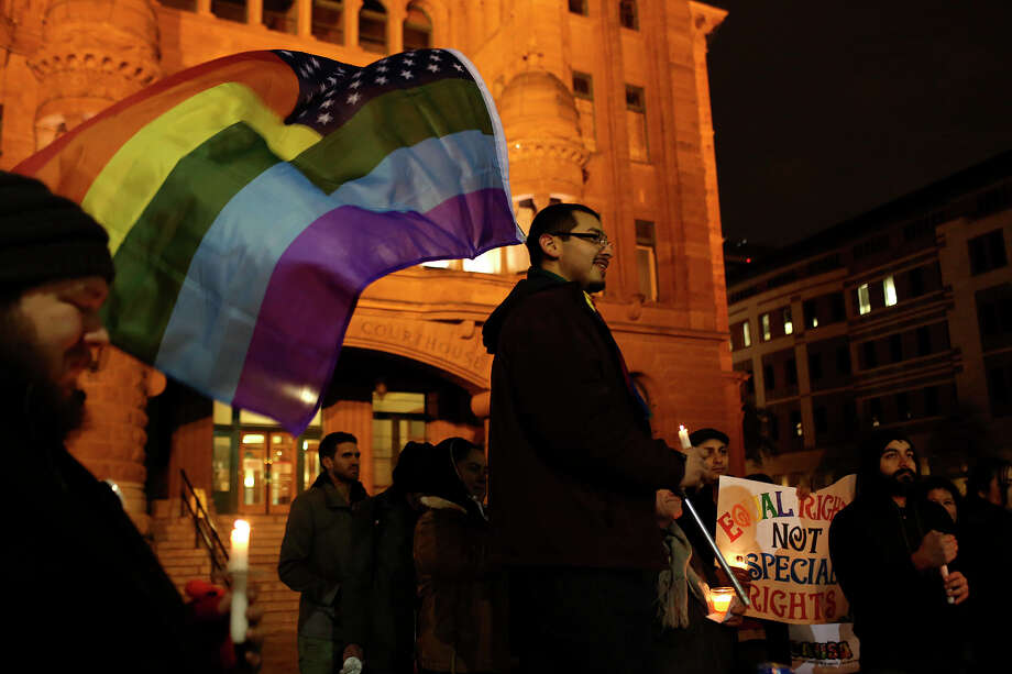 "Supporters of marriage equality including Julius Lorenzi, center, participate in the ""Light The Path to Marriage Equality"" candlelight vigil outside the Bexar County Courthouse in San Antonio on Tuesday, Feb. 11, 2014. Photo: Lisa Krantz / San Antonio Express-News"