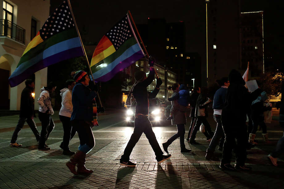 "Supporters of marriage equality cross Commerce Street  during the ""Light The Path to Marriage Equality"" march from Milam Park to the Bexar County Courthouse in San Antonio on Tuesday, Feb. 11, 2014. Photo: Lisa Krantz / San Antonio Express-News"