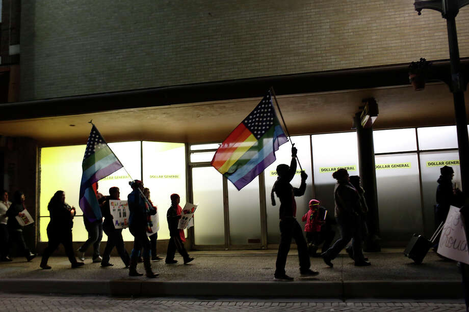 "Supporters of marriage equality march during the ""Light The Path to Marriage Equality"" march from Milam Park to the Bexar County Courthouse in San Antonio on Tuesday, Feb. 11, 2014. Photo: Lisa Krantz / San Antonio Express-News"