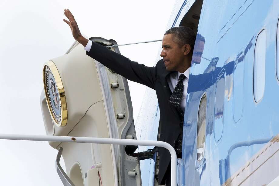 President Obama boards Air Force One at Andrews Air Force Base, Md., en route to St. Paul, Minn., where he toured a light-rail maintenance facility. Photo: Jacquelyn Martin, Associated Press