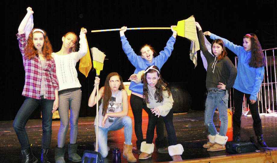 Rehearsing a musical number in ìReizendheim Ö A Classic Fairy Tale Retold,î at Roger Ludlowe Middle School are, from left: Tess Noonan,13; Grace Pelle, 13; Bella Mercado, 12; Fiona Carter, 12; Emerson Raymond, 12; Stephanie Barry, 13; and Amber Smith, 12. Photo: Staff Photo/Gretchen Webster / Fairfield Citizen
