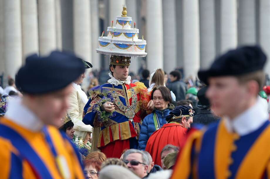 He can have his cake and wear it too: A carnival reveler awaits Pope Francis' general audience in St. Peter's Square at the Vatican. Photo: Vincenzo Pinto, AFP/Getty Images