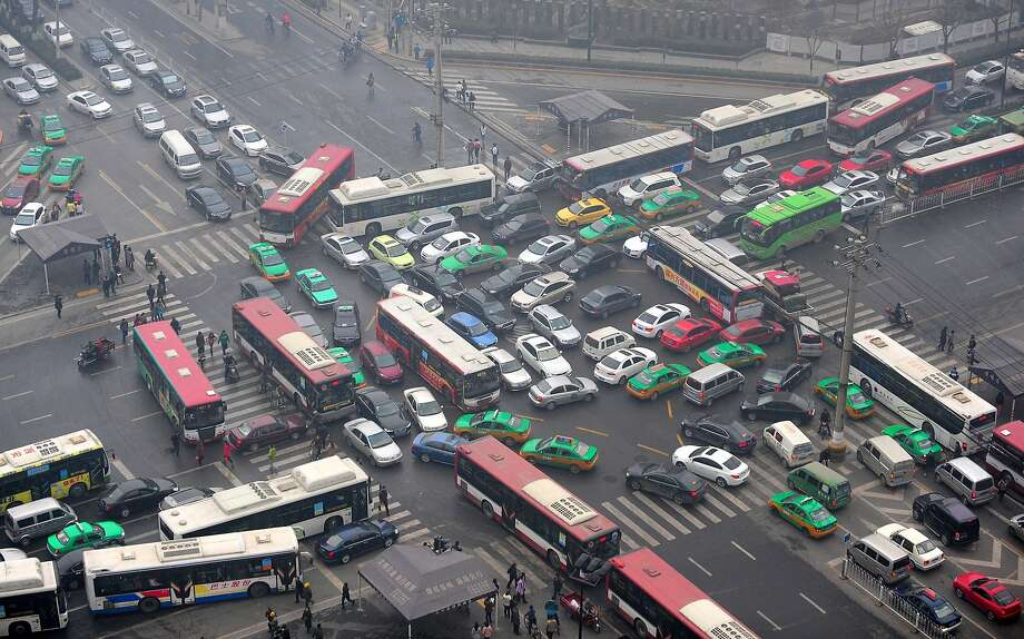 Now if everyone just takes their turn in an orderly fashion ... Traffic is jammed in all directions after signal lights go out at an intersection in Xi'an, China. Photo: ChinaFotoPress, Getty Images