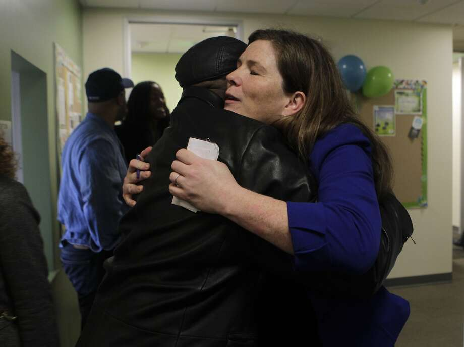 Suzy Loftus, COO of the Center for Youth Wellness, hugs G.L. Hodge after a tour of the Bayview Child Health Center in San Francisco, Calif. on Wednesday, Feb. 26, 2014. The facility combines the services of a health clinic, wellness center and child abuse prevention center under one roof. Photo: Paul Chinn, The Chronicle