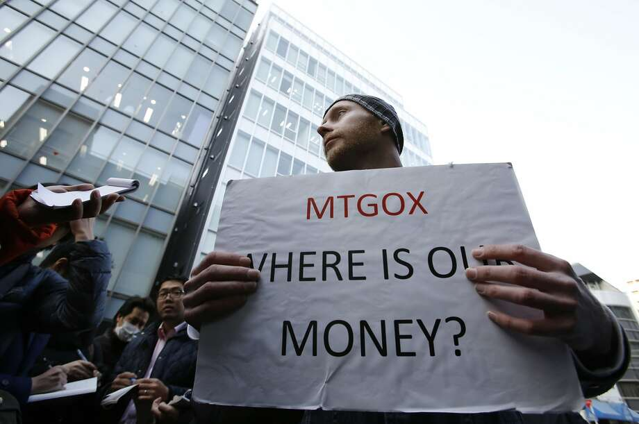 Kolin Burges, a London bitcoin trader, protests outside Mt. Gox after its collapse. Photo: Toru Hanai, Reuters