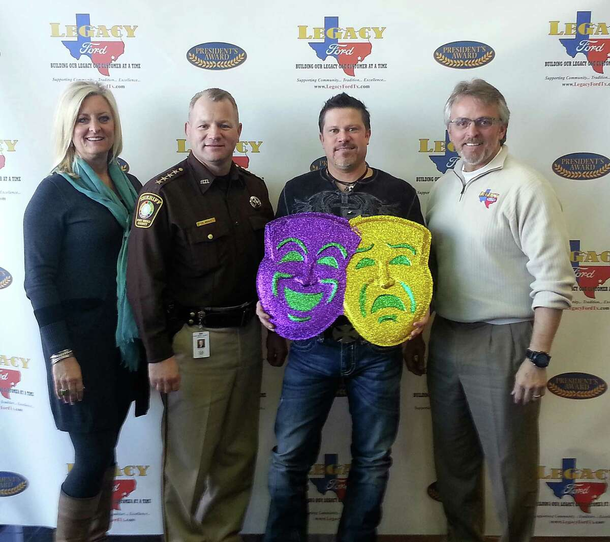 Getting ready for Mardi Gras are Central Fort Bend Chamber President/CEO Shanta Kuhl, left, Fort Bend County Sheriff Troy Nehls, St. Michael's Emergency Room owner Shannon Orsak and Legacy Ford owner Ron Ewer.