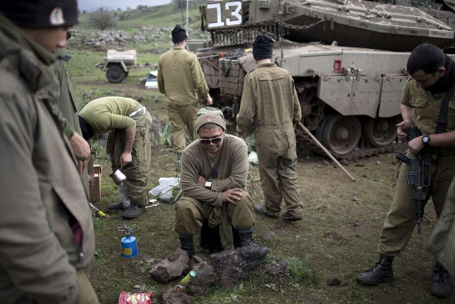 Israeli soldiers relax in the Israeli-controlled Golan Heights. Hezbollah says an Israeli air strike targeted its positions inside Lebanon. Photo: Ariel Schalit, Associated Press