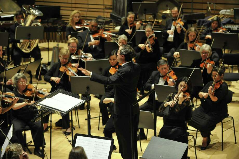 David Alan Miller conducts the Albany Symphony Orchestra in the Verdi Requiem in January 2011. (Gary D. Gold Photography) Photo: GOLD / GARY GOLD