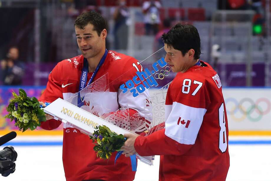 Canada's Patrick Marleau (left) and Sidney Crosby celebrate with the team trophy after winning gold. Photo: Martin Rose, Getty Images