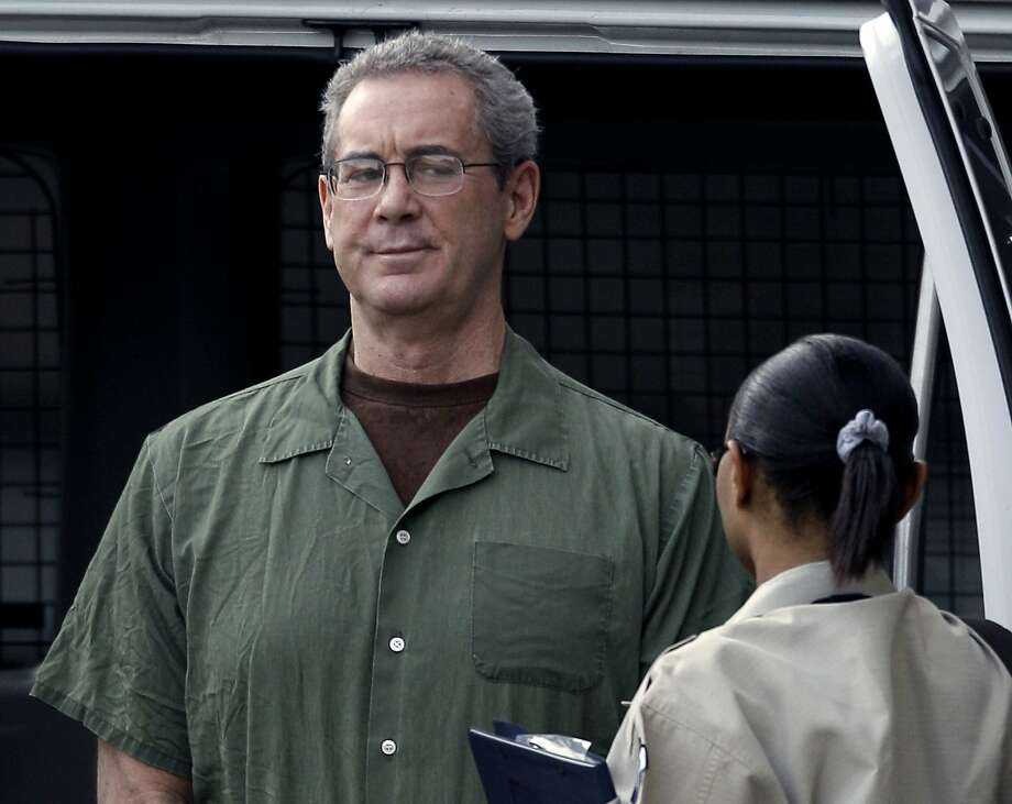 FILE - In this Aug. 24, 2010 file photo, R. Allen Stanford arrives in custody at the federal courthouse for a hearing in Houston. The Supreme Court ruled Wednesday that class-action lawsuits from investors who lost billions in former Texas tycoon R. Allen Stanford's massive Ponzi scheme can go forward. The decision is a loss for individuals, law firms and investment companies that allegedly aided Stanford's fraud and wanted the lawsuits thrown out. (AP Photo/David J. Phillip, File) Photo: David J. Phillip, Associated Press