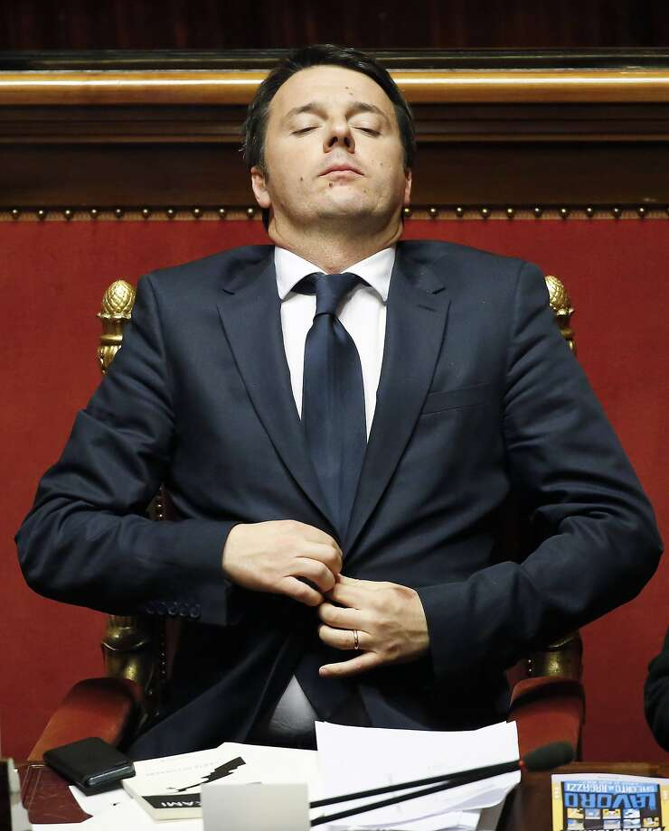 Italy's Prime Minister Matteo Renzi adjust his suit jacket during a confidence vote at the Senate in Rome February 24, 2014. Renzi, approaching a confidence vote in his new government on Monday, pledged to cut labour taxes, free up funds for investment in schools and pass wide institutional reforms to tackle Italy's economic malaise. REUTERS/Remo Casilli  (ITALY - Tags: POLITICS) Photo: Remo Casilli, Reuters