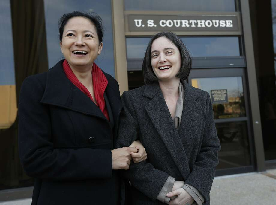 Cleopatra De Leon (left) and wife Nicole Dimetman, one of two couples challenging Texas' ban on same-sex marriage, arrive at the federal courthouse in San Antonio earlier this month. Photo: Eric Gay, Associated Press