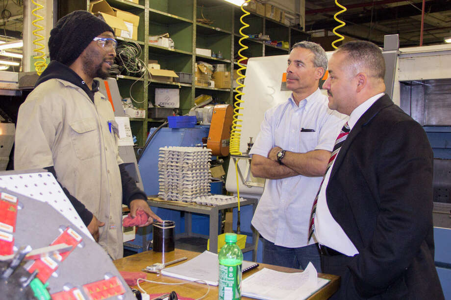 Senator Andres Ayala speaks with Gerald Cavallo, President of James Ippolito & Co in Bridgeport, and Chris, one of his employees hired through Connecticut's STEP-Up program. Photo: Contributed Photo / Stamford Advocate Contributed