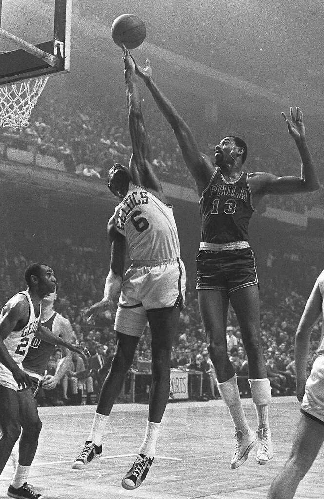 Boston Celtics Bill Russell (6) outreaches Philadelphia 76ers Wilt Chamberlain (13) to control a rebound in Boston in this Jan. 15, 1967 photo.