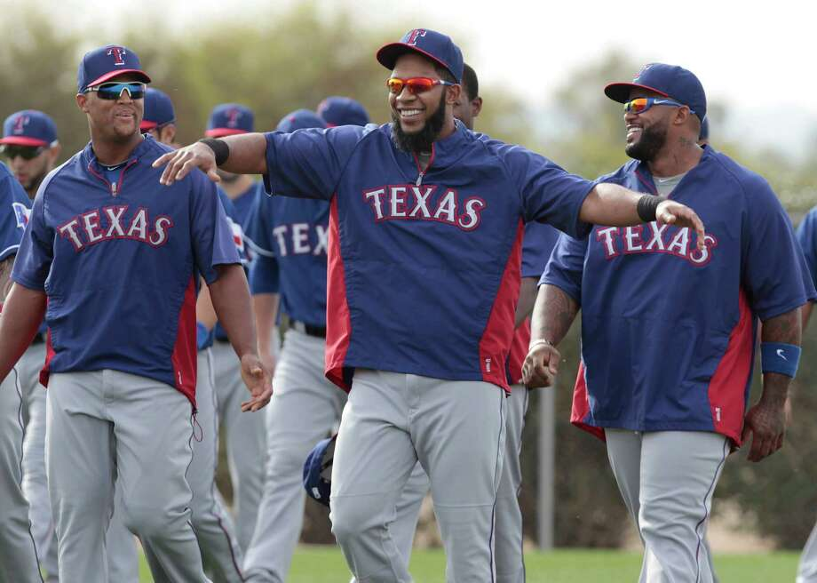 Texas Rangers infielders Adrian Beltre, left, and Prince Fielder, right, are entertained by Elvis Andrus during warm ups at baseball spring training camp in Surprise, Ariz., on Friday, Feb. 21, 2014.   MAGS OUT; (FORT WORTH WEEKLY, 360 WEST); INTERNET OUT Photo: Ron T. Ennis, AP / Fort Worth Star-Telegram