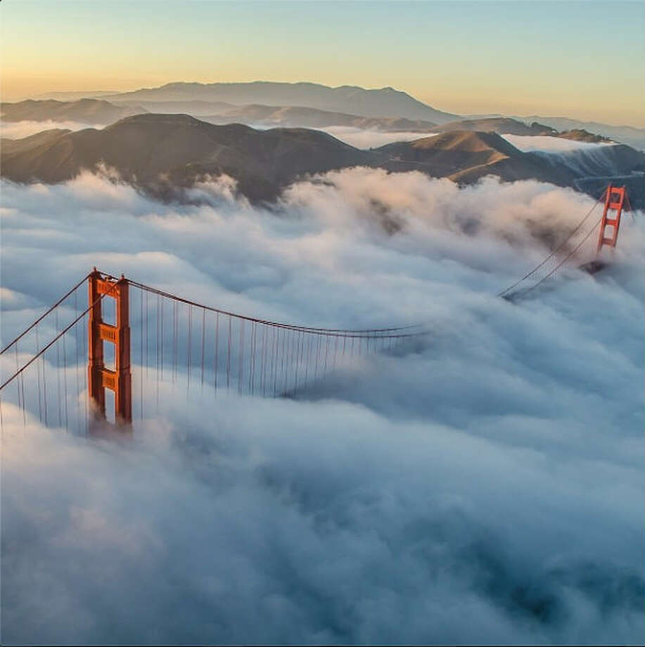 "Chris H., a professional photographer who goes by @independentcbh on Instagram, took this aerial shot and writes: ""I've flown a lot over San Francisco, but the day was just the perfect amount of fog over the Golden Gate to make for an unforgettable shot of my favorite bridge in the world."""
