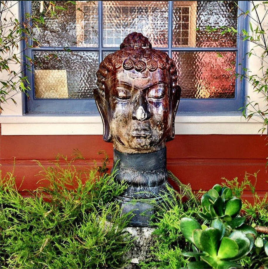 "Everybody wants to find a slice of solace in the busy city. Julie G., or @juliegeb on Instagram, found this bust of the Buddha in SoMa. She calls it ""the watchful Buddha."""