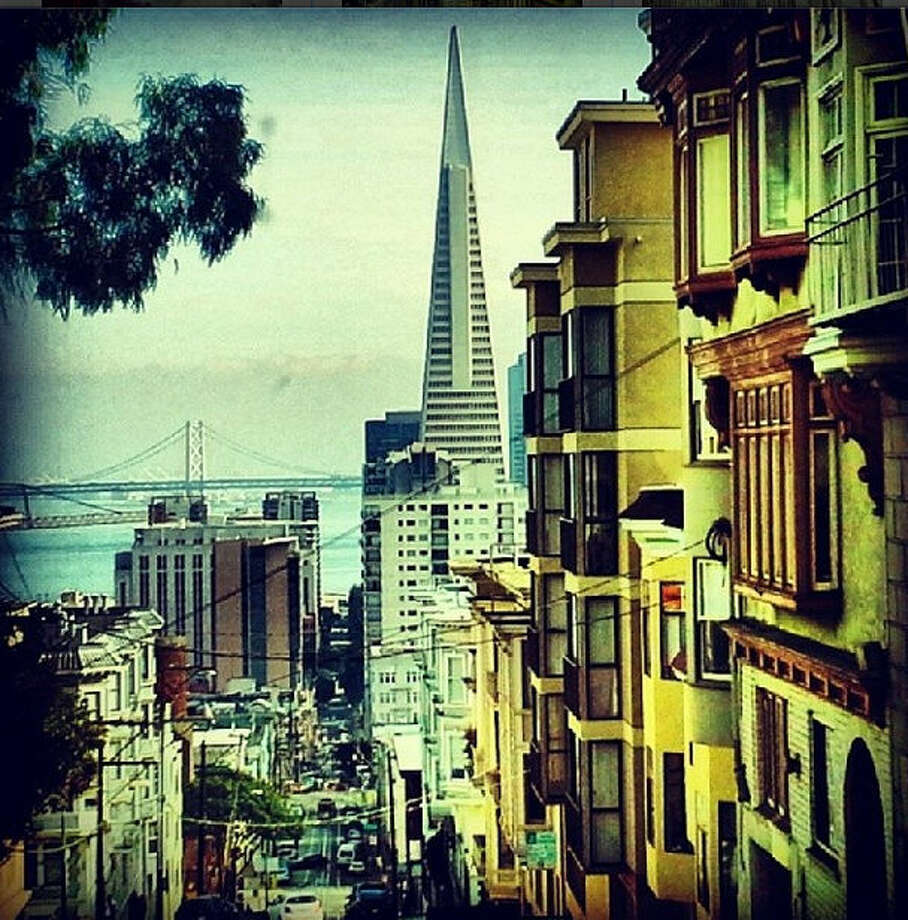 "Adrian W., known as @vladsdad took this vintage-looking shot of the city from Nob Hill. Adrian writes: ""This photo depicts the tight streets and beautiful views descending from Nob hill into Chinatown"""