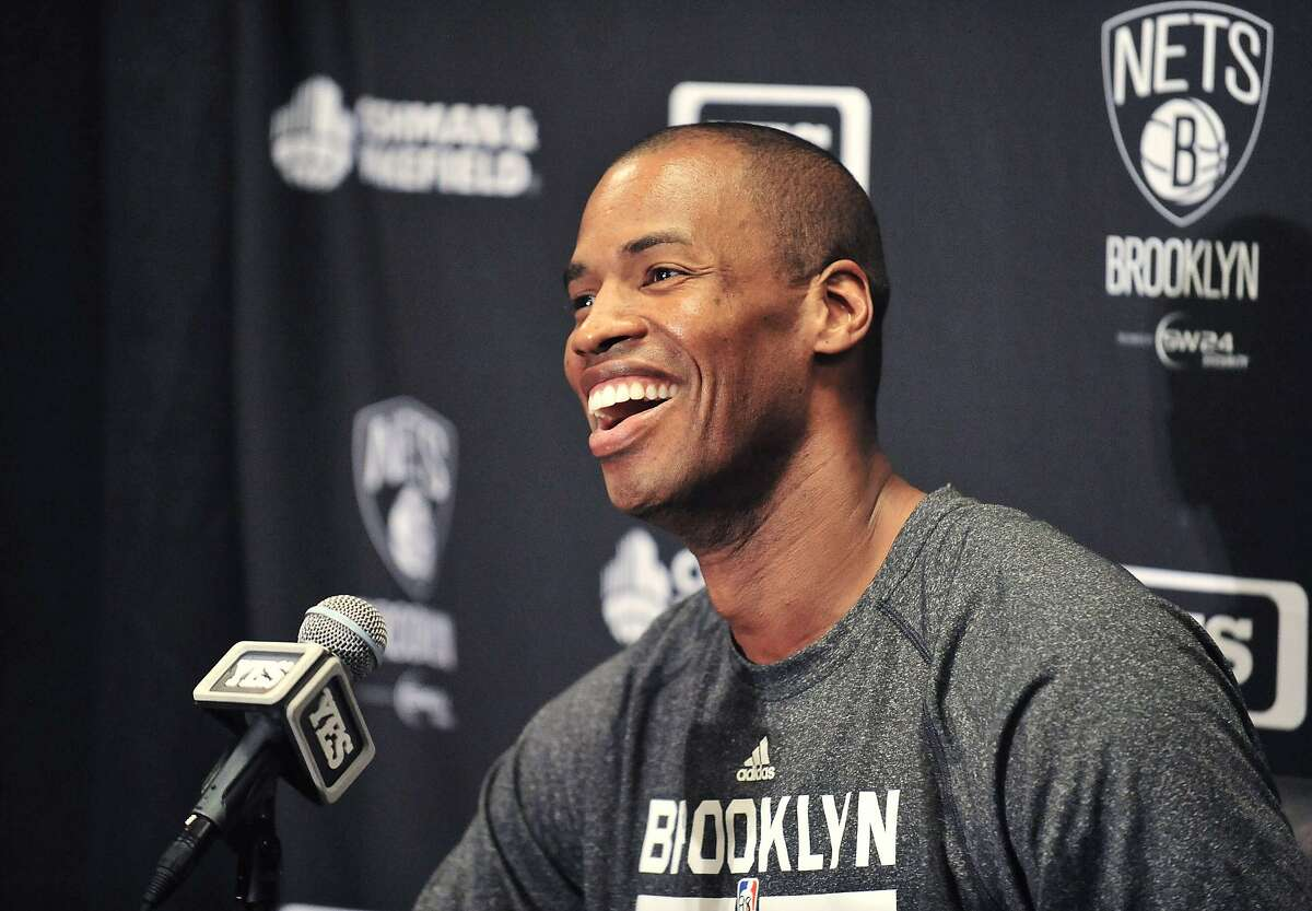 Brooklyn Nets Jason Collins speaks to media before playing against the Los Angeles Lakers at Staples Center in Los Angeles in this file photo taken February 23, 2014. Collins, 35, had been without a team after publicly coming out as gay in April 2013. Last weekend, he signed a 10-day contract with the Brooklyn Nets and made history on Sunday as the first openly gay athlete to play in North America's major leagues. REUTERS/Gary A. Vasquez-USA TODAY Sports (UNITED STATES - Tags: SPORT BASKETBALL SOCIETY)