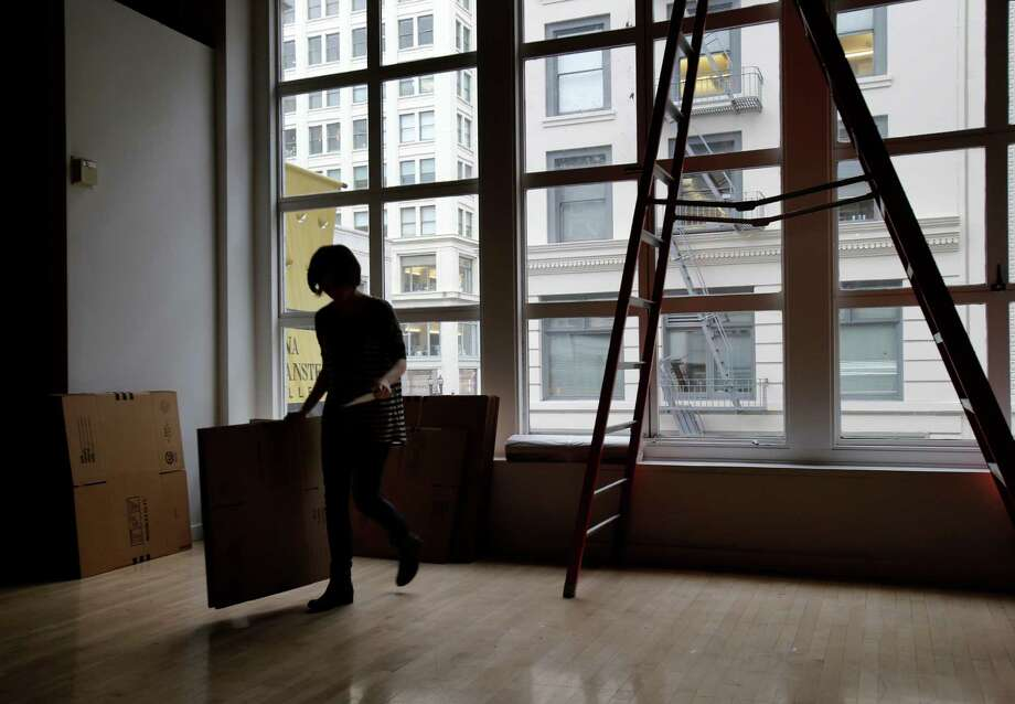 Jessica Daniel of the Rena Bransten Gallery retrieved more boxes for the upcoming move in San Francisco, Calif. Wednesday February 26, 2014. Rising rents in downtown San Francisco are forcing some gallery owners to move like the Rena Bransten Gallery on Geary Street. Photo: Brant Ward / The Chronicle / ONLINE_YES