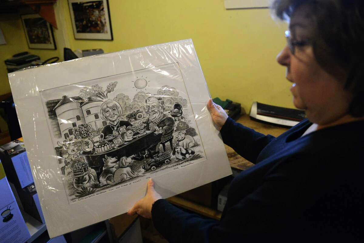 Silo employee Liba Furhman shows a caricature of Ruth Henderson and her husband, the late composer Skitch Henderson, The Silo in New Milford, Conn. Wednesday, Feb. 26, 2014. Ruth Henderson, wife of the late composer Skitch Henderson, died at her home on the Hunt Hill Farm property Tuesday night. Henderson had fame as a fashion model before opening The Silo at Hunt Hill Farm in 1972.