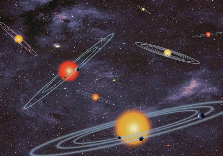 Our galaxy is looking far more crowded as NASA confirmed a bonanza of 715 newly discovered planets circling stars other than our sun. Photo: NASA Illustration / Associated Press / NASA