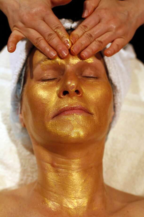 Jarilyn Lim gives a gold facial to client Leslie Anderson, of Pacific Grove, at Jarilyn's Spa Retreat in Carmel-by-the-Sea, Calif., on Thursday, February 20, 2014. Photo: Sarah Rice, Special To The Chronicle