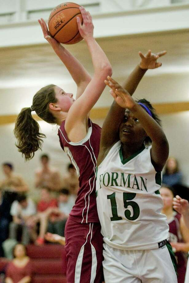 Wooster School's Blair Hamilton tries to get off a shot while Forman School's Lacey McCaw tries to block during the quarterfinals of the NEPSAC Class E tournament at Wooster School in Danbury Conn. Wednesday, Feb. 26, 2014 Photo: Scott Mullin / The News-Times Freelance