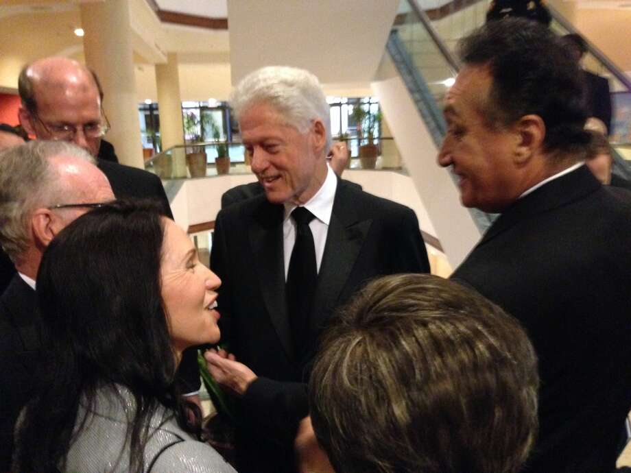 Former President Bill Clinton, along with Former San Antonio Mayor and Housing Secretary Henry Cisneros, before a ceremony where Clinton will be presenting Cisneros with an award.
