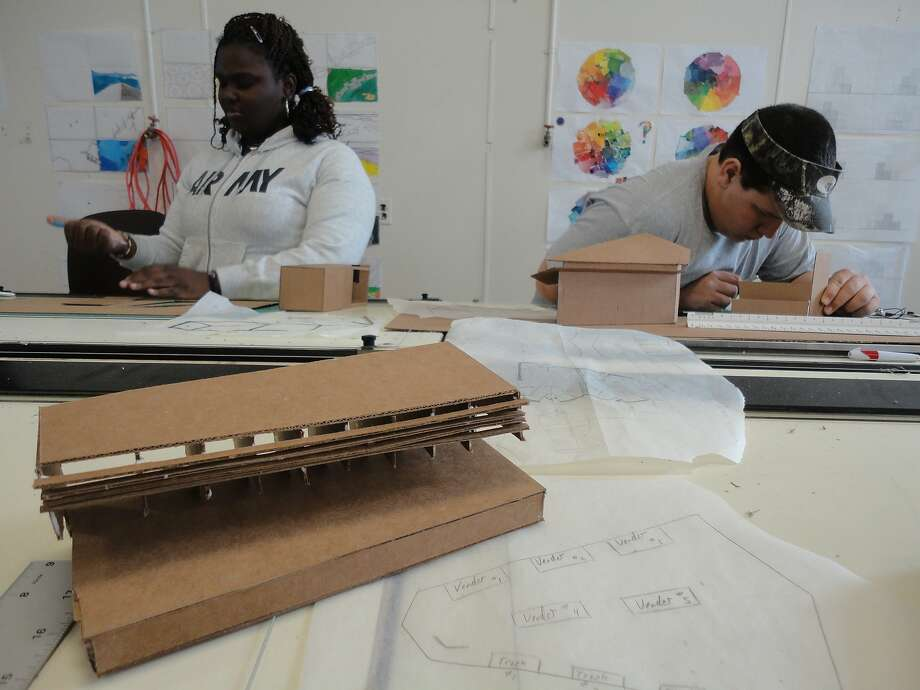 Studio H students Jamesha Thompson and Rodecoe Dunlow at work in the studio. From IF YOU BUILD IT, a Long Shot Factory Release 2013. Photo: Long Shot Factory