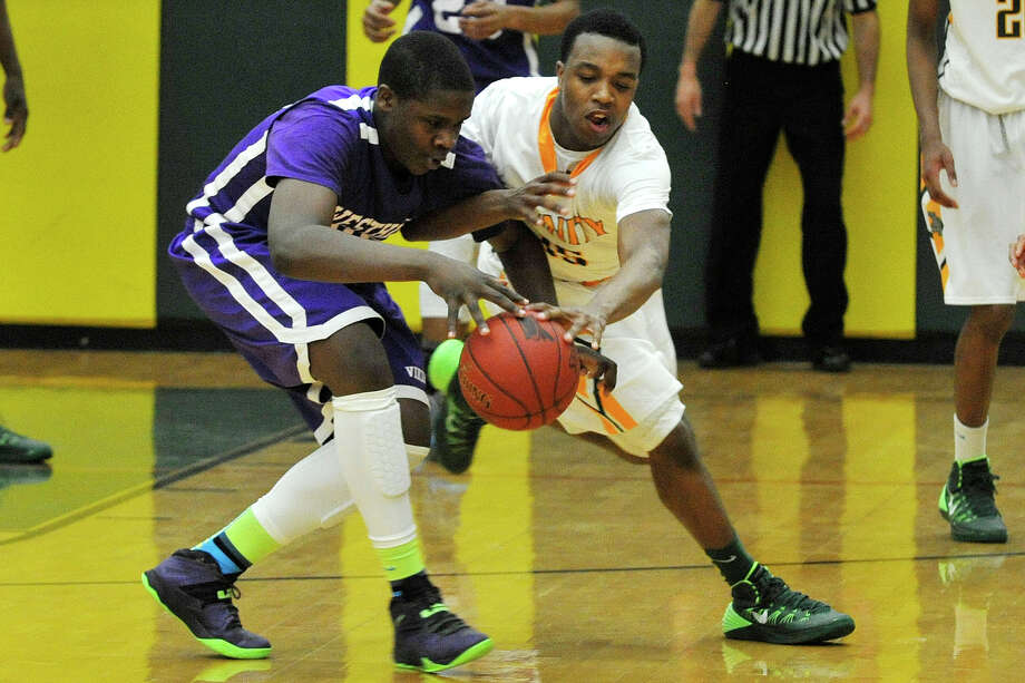 Trinity Catholic's Tyrell St. John attempts to steal the ball from Westhill's Tyrell Alexander during their game at Trinity Catholic High School in Stamford, Conn., on Wednesday, Feb. 26, 2014. Westhill won, 67-63. Photo: Jason Rearick / Stamford Advocate