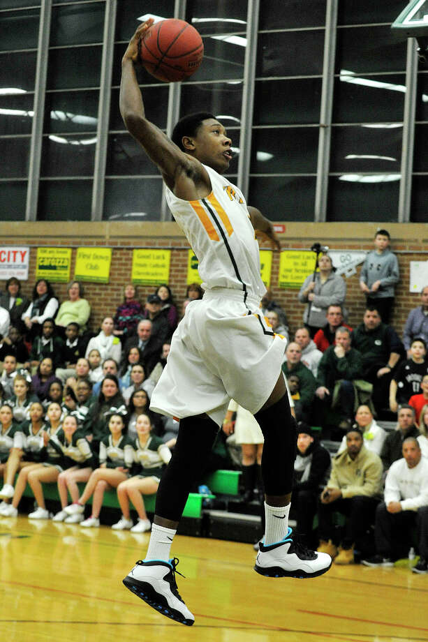 Trinity Catholic's Tremaine Fraiser dunks the ball during their game against Westhill at Trinity Catholic High School in Stamford, Conn., on Wednesday, Feb. 26, 2014. Westhill won, 67-63. Photo: Jason Rearick / Stamford Advocate