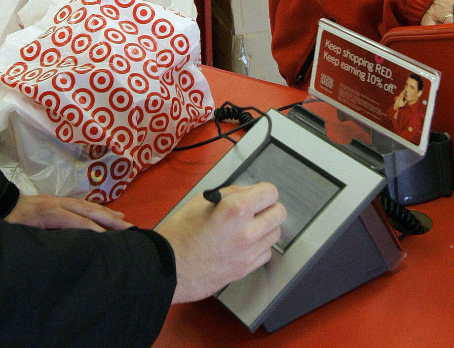 The costs of Target's data breach might eclipse a similar theft in 2007 at TJX Cos., the largest for a retailer on record. One security analyst put the costs of the Target breach between $400 million and $450 million. Photo: Associated Press File Photo / AP