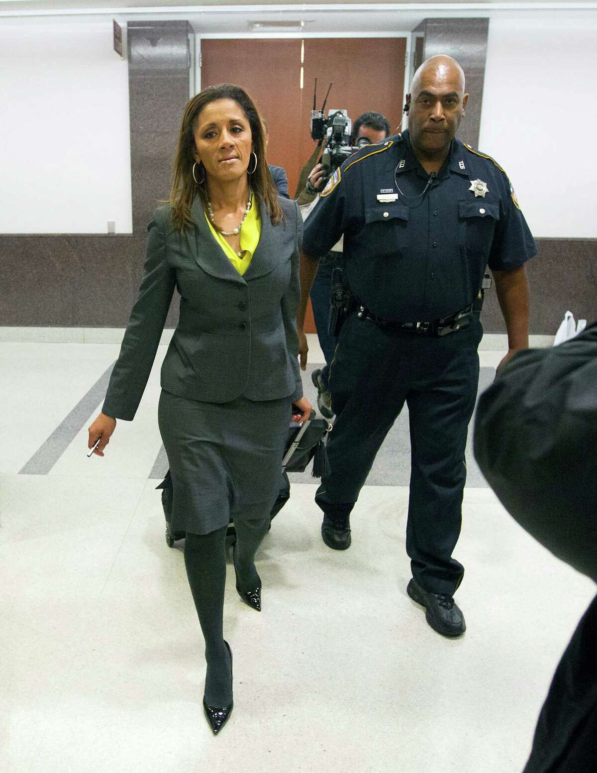 Tammy Adams leaves court after appearing on behalf of a teen accused of abandoning her baby.