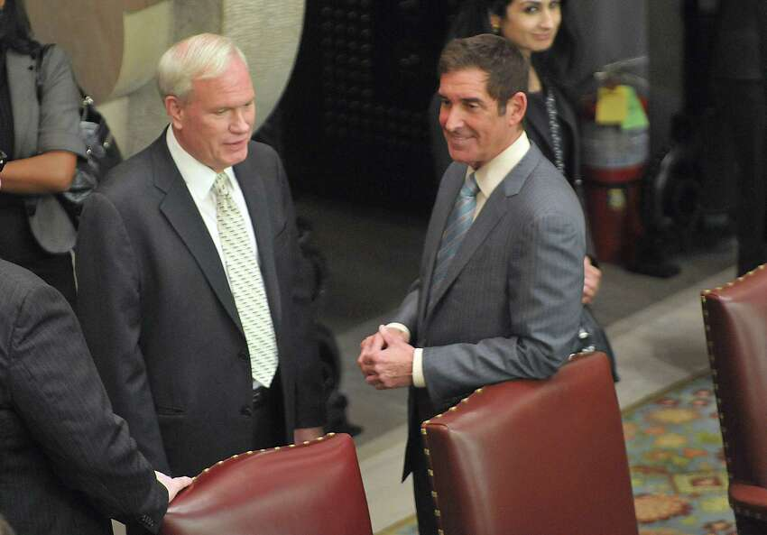 Senator Tony Avella, left, and Senator Jeff Klein talk inside the Senate Chambers near their seats on Wednesday, Feb. 26, 2014, inside the Senate Chamber in Albany, N.Y. Senator Avella has left the main Democratic conference in favor of the breakaway Independent Democratic Conference, which Senator Klein leads. (Paul Buckowski / Times Union)