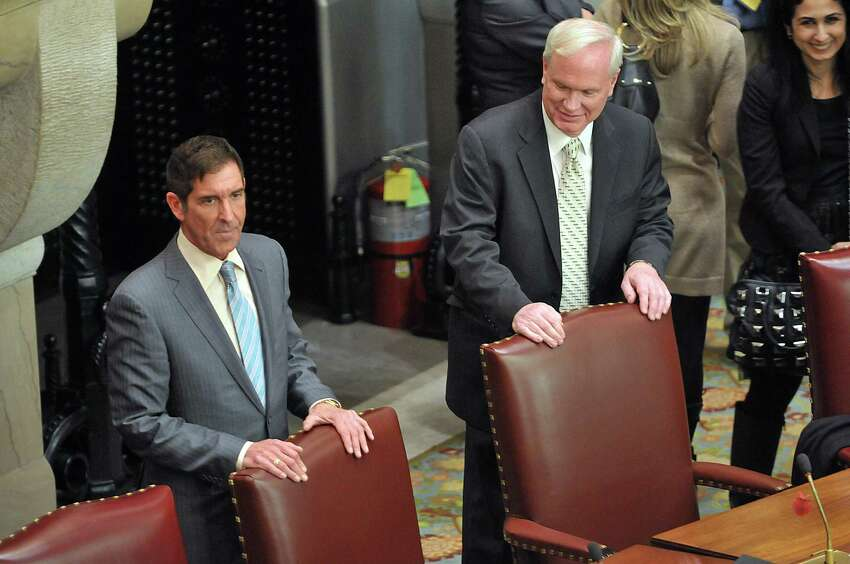 Senator Jeff Klein, left, and Senator Tony Avella stand inside the Senate Chambers near their seats on Wednesday, Feb. 26, 2014, inside the Senate Chamber in Albany, N.Y. Senator Avella has left the main Democratic conference in favor of the breakaway Independent Democratic Conference, which Senator Klein leads. (Paul Buckowski / Times Union)