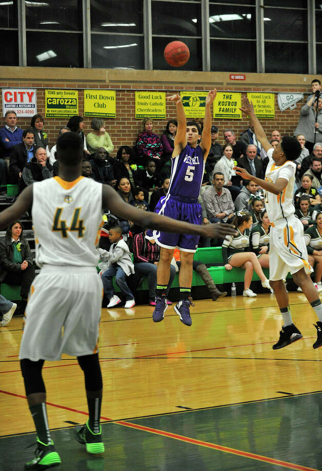 Westhill's Evan Skoparantzas shoots a three-pointer during the Vikings' game against Trinity Catholic at Trinity Catholic High School in Stamford, Conn., on Wednesday, Feb. 26, 2014. Westhill won, 67-63. Photo: Jason Rearick / Stamford Advocate