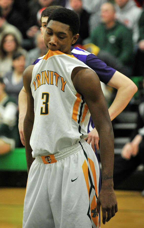Trinity Catholic's Tremaine Fraiser waits for a free-throw during their game against Westhill at Trinity Catholic High School in Stamford, Conn., on Wednesday, Feb. 26, 2014. Westhill won, 67-63. Photo: Jason Rearick / Stamford Advocate